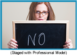 "Woman holding halkboard with the word ""NO"" written on it (Staged with a Professional Model)."