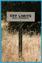 "Sign in the middle of a field saying ""OFF LIMITS"""