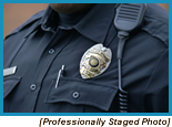 Police badge on the chest of a police officer (Staged with Professional Model).